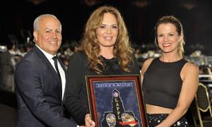 Peter Repovich (l) and Melissa Claire Egan (r) presented to honoree Catherine Bach.