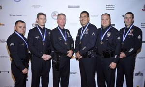 LAPPL's Distinguished Service Award recipients were honored on stage at the 2015 Eagle & Badge Gala.
